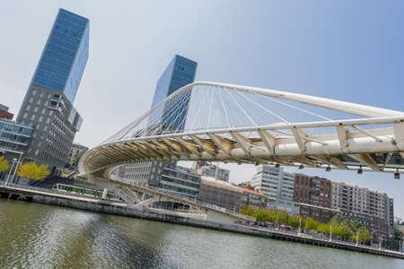 BILBAO-JULY 19  Zubizuri Bridge, Santiago Calatrava in Bilbao, Spain, on July 19, 2013  It is an arch bridge that hangs over Nervion river