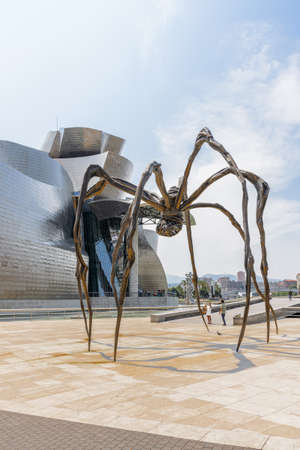 BILBAO, SPAIN- JULY 19  Bronze sculpture, steel and marble, seen from below, and located at the rear of the Guggenheim Museum Bilbao, Spain, on July 19, 2013  It is the most visited tourist site Editorial