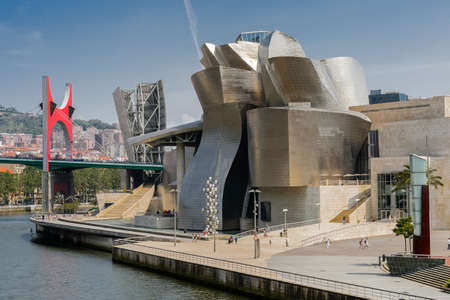 frank gehry: BILBAO, SPAIN - July 19  Exterior of The Guggenheim Museum on July 19, 2013 in Bilbao, Spain  The Guggenheim is a museum of modern and contemporary art designed by Canadian-American architect Frank Gehry