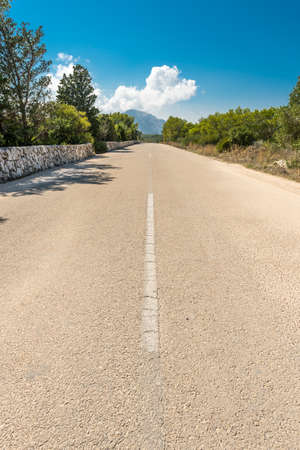 Paved road through San Antonio Cape in Javea, Spain
