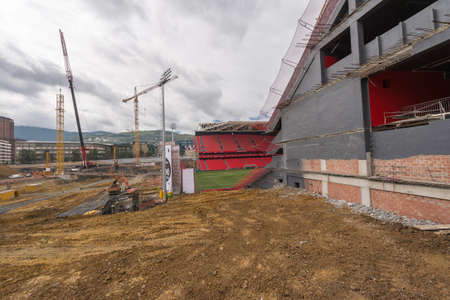 BILBAO, SPAIN - SEPTEMBER 18  Workers removing the land to build the last tier of the football stadium of San Mames in Bilbao, Spain, on September 18, 2013  The architect of this project is Cesar Azkarate  Editorial