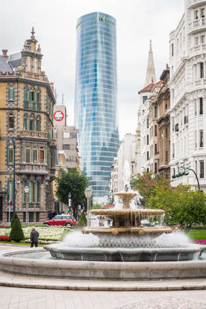 BILBAO, SPAIN - SEPTEMBER 18  Moyua square and Iberdrola Tower headquarters, in Bilbao, Spain, on September 18, 2013  The tower was designed by architect Caesar Pelli in 2011