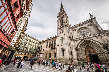 BILBAO, SPAIN - SEPTEMBER 27, 2013  Tourists and citizens walking in front of the Cathedral of Santiago in Bilbao, Spain on September 27, 2013  Editorial