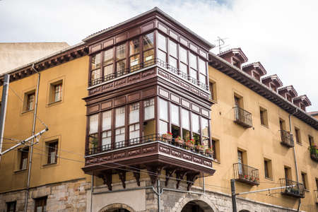 Antique house with wooden balcony in Bilbao, Spain