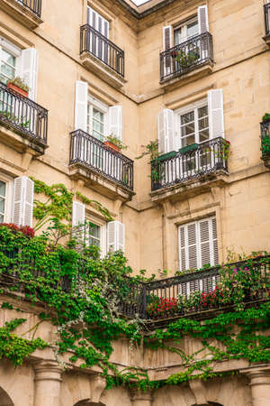 Balconies with flowers and plants in Bilbao, Spain Stock Photo