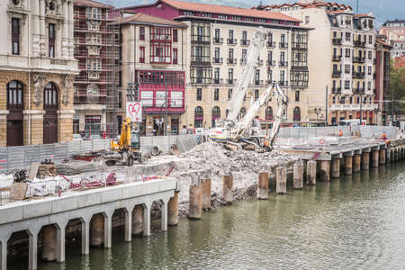 BILBAO, SPAIN - SEPTEMBER 27  Workers building the pier in front of Arriaga Theater in Bilbao, Spain, on September 27, 2013  It is the main theater and most notable building in the town