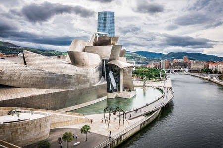 BILBAO, SPAIN - OCTOBER 1  Exterior of The Guggenheim Museum and Iberdrola Tower on October 1, 2013 in Bilbao, Spain  The Guggenheim is a museum of modern and contemporary art designed by Canadian-American architect Frank Gehry