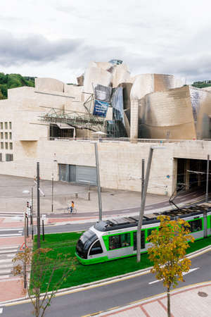frank gehry: BILBAO, SPAIN - OCTOBER 1  Exterior of The Guggenheim Museum and Tram transport on October 1, 2013 in Bilbao, Spain  The Guggenheim is a museum of modern and contemporary art designed by Canadian-American architect Frank Gehry