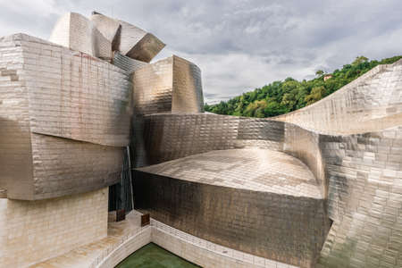 frank gehry: BILBAO, SPAIN - OCTOBER 1  Exterior of The Guggenheim Museum on October 1, 2013 in Bilbao, Spain  The Guggenheim is a museum of modern and contemporary art designed by Canadian-American architect Frank Gehry Editorial