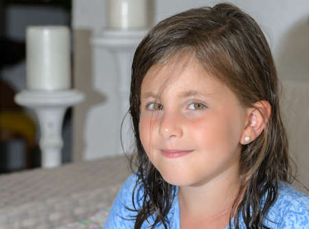 little girl setting smile at the camera Stock Photo
