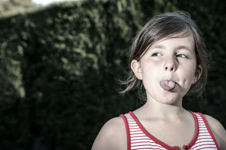 little girl sticking out her tongue Stock Photo