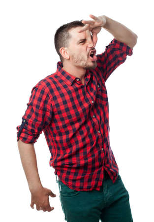 Young man over white background. Bad smell Stock Photo