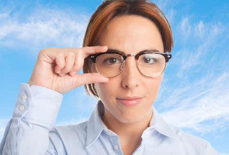 bifocals: Business woman over clouds background. Wearing glasses