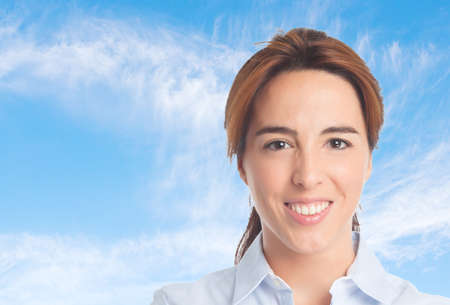 Business woman over clouds background. Looking confident Stock Photo