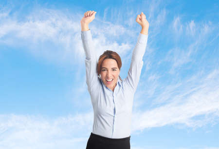 Business woman over clouds background. Looking successful