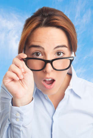 Business woman over clouds background. Looking surprised Stock Photo