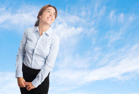 Business woman over clouds background. Looking funny Stock Photo
