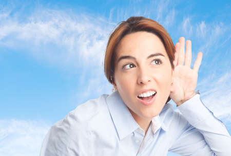 Business woman over clouds background. Trying to pay attention