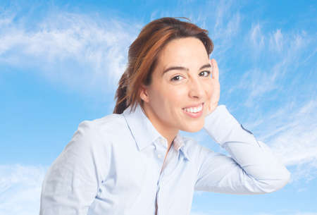earing: Business woman over clouds background. Earing some noise