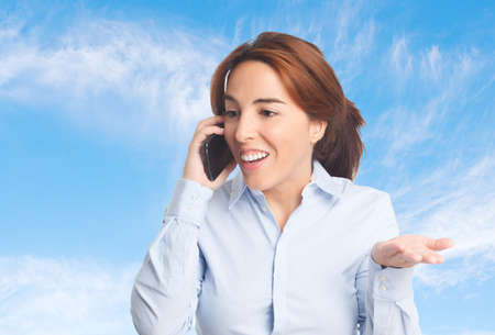 Business woman over clouds background. Using a smartphone