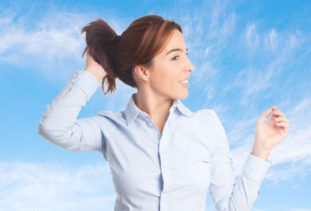 Business woman over clouds background. Looking sexy Stock Photo