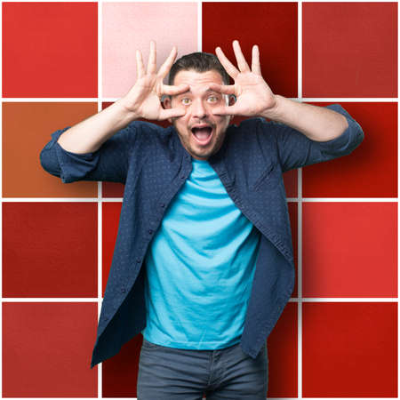 loony: Young man wearing a blue outfit. Looking funny. Stock Photo