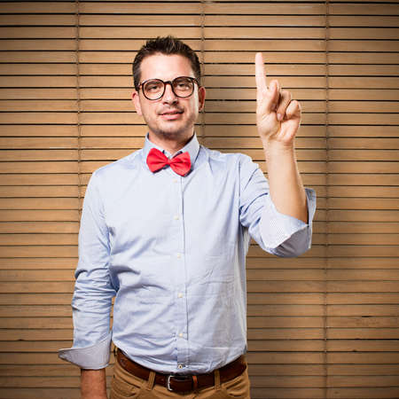 palm reading: Man wearing a red bow tie. Doing one number gesture.