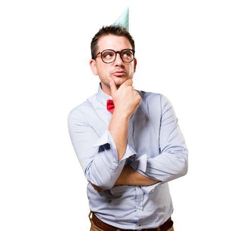 reflexion: Man wearing a red bow tie and party hat. In a deep reflexion. Stock Photo
