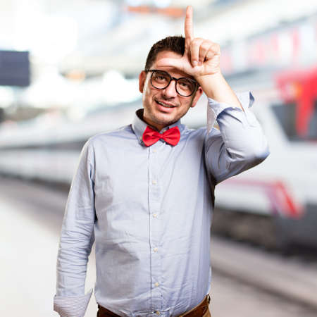 Man wearing a red bow tie. Looser gesture.