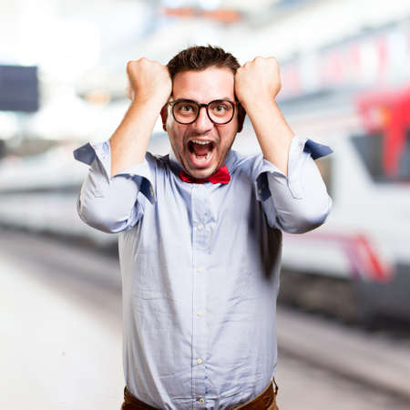 Man wearing a red bow tie. Looking crazy. Stock Photo