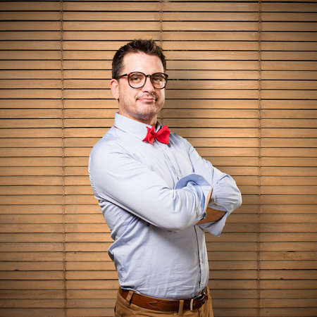 Man wearing a red bow tie. Looking confident. Stock Photo