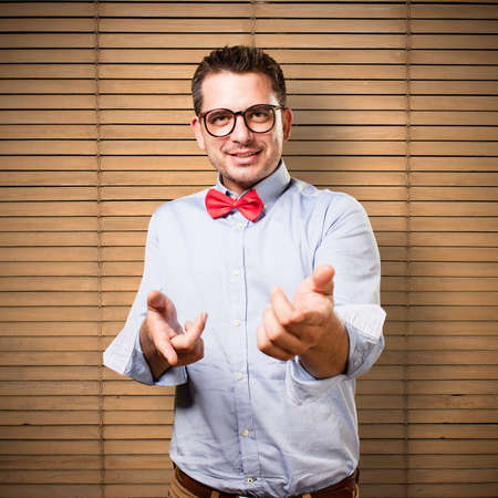 palm reading: Man wearing a red bow tie. Looking confident. Stock Photo