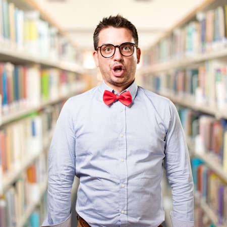 Man wearing a red bow tie. Looking funny. Stock Photo