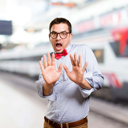 Man wearing a red bow tie. Looking scared.