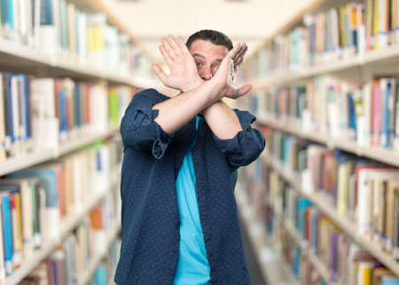 Young man wearing a blue outfit. Looking scared. Stock Photo
