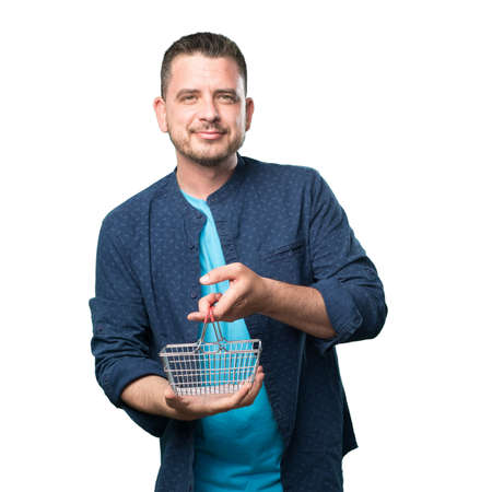 Young man wearing a blue outfit. Holding a shopping basket.
