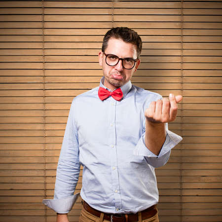 Man wearing a red bow tie. Doing money gesture.
