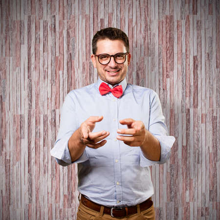 Man wearing a red bow tie. Looking funny