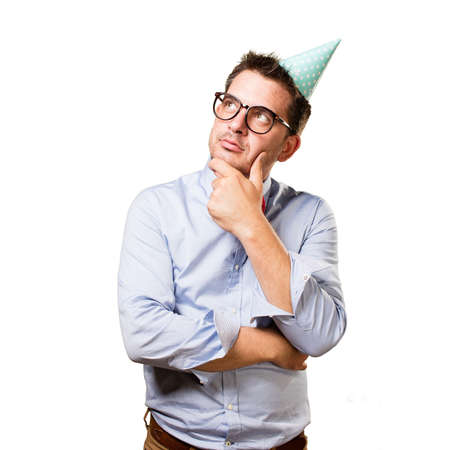 Man wearing a red bow tie and party hat. In a deep reflexion. Stock Photo