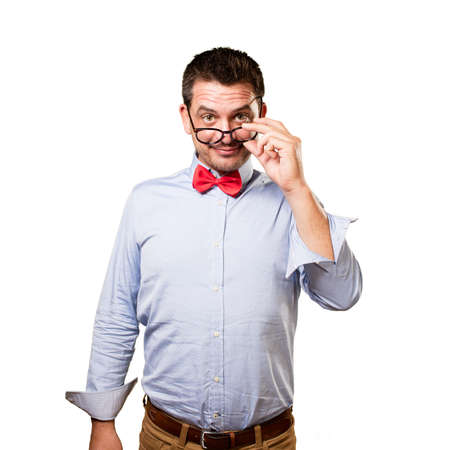 Man wearing a red bow tie. Looking over glasses.