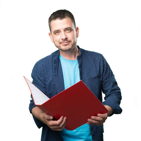 Young man wearing a blue outfit. Holding a red folder.