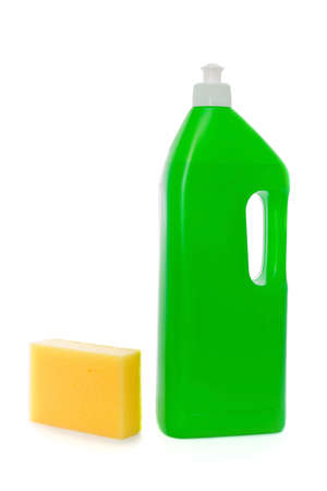 orange washcloth: Yellow sponge and green bottle with dish soap on white background Stock Photo