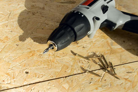 drill floor: Drill with Screws with shadows on the floor