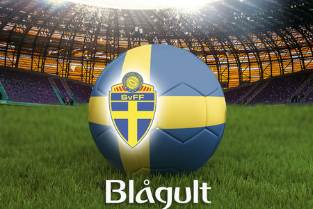 Blue-Yellow on Swedish language on football team ball on big stadium background. Sweden Team competition concept. Sweden flag on ball team tournament. Sport competition on green grass background