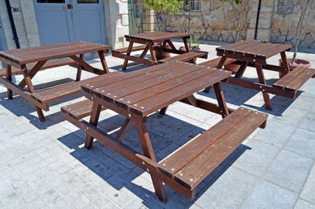 Wooden tables and benches photo