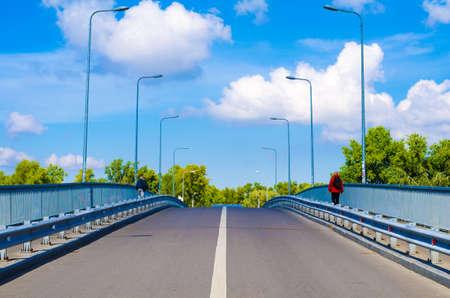 bridging the gap: Pedestrian bridge against the blue sky background