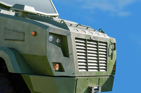 armored: Armored army Car on a blue sky background Stock Photo