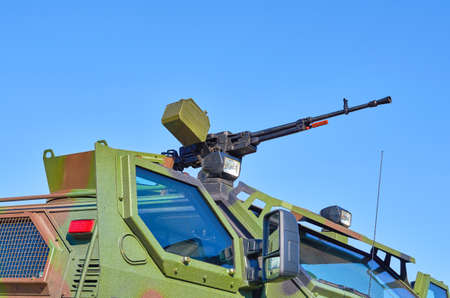armoured: One machine gun on a armoured carrier Stock Photo