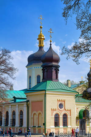 The Botanical Garden and near the subway Vydubychi are ancient and the Holy Trinity-St Jonah monastery at fall, where monks pray and citizens. Stock Photo