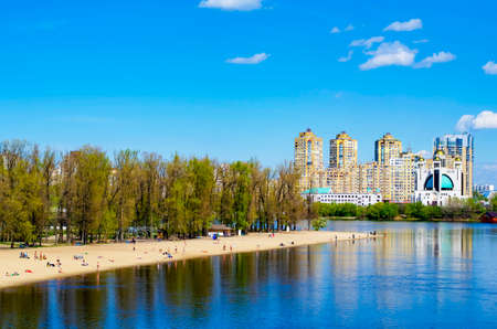 housing search: Residential highrises near the river. Apartments. Kiev Ukraine